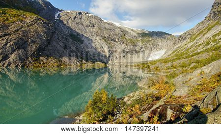 Autumn in the mountains in Norway. Glacial lake.