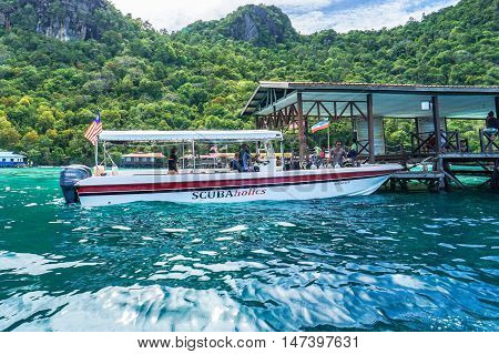 Semporna,Sabah-Sept 10,2016:Speedboat with tourists arrived at Bohey Dulang jetty Semporna,Sabah on 10th Sept 2016.Bohey Dulang in Sabah become a tourist attraction for diving & enjoy the marine life