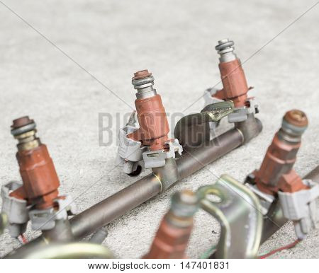 Old and used fuel injectors and fuel injector rail for gasoline engine selective focus
