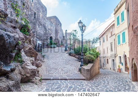 the beautiful alley of castelsardo old city - sardinia - italy poster