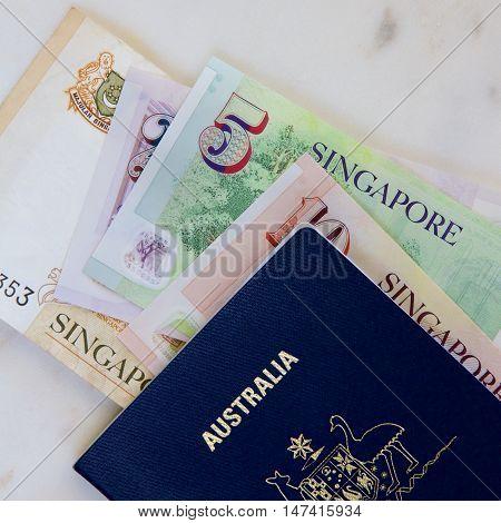 Australian passports with some Singaporean dollars notes.