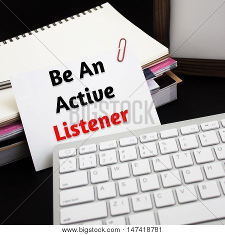 Word text Be an active listener on white paper card / business concept
