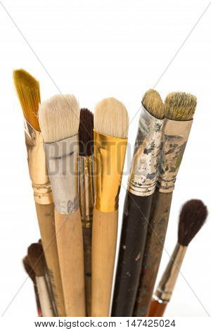 a lot of paint brushes over white background