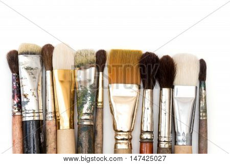 a paint brushes over white  a background