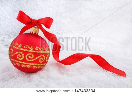 Christmas decorations Red Christmas ball with ribon in the snow