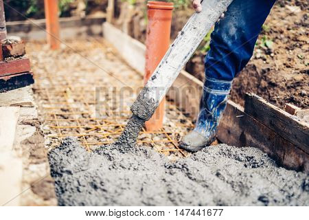 Construction Site Details - Building Sidewalks And Pouring Cement On Reinforcement Bars