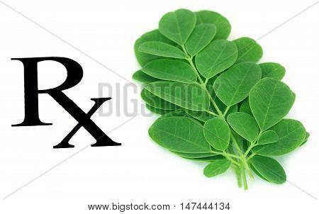 Moringa leaves prescribed as herbal medicine over white background