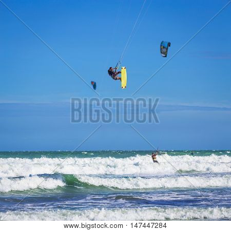 Athletic Man Jump On Kite Surf Board In Sea Waves