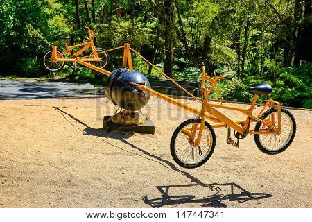Pedal Powered swinging 'bicycle' roundabout playground eguipment.
