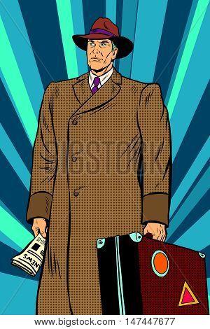 Retro man in cloak with suitcase, pop art retro vector illustration. Autumn clothing