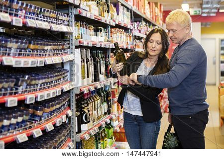 Couple Scanning Bottle's Barcode On Smartwatch
