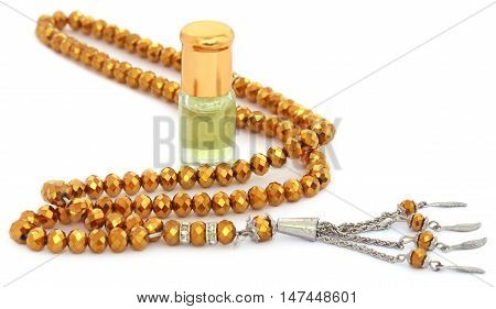 Rosary with perfume that indicates a religious matter