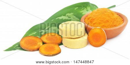 Turmeric with other herbal products for beautification over white background