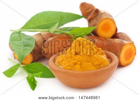 Turmeric with henna leaves over white background