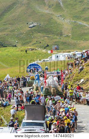 Col du Glandon France - July 23 2015: Carrefour caravan during the passing of the Publicity Caravan on Col du Glandon in Alps during the stage 18 of Le Tour de France 2015.