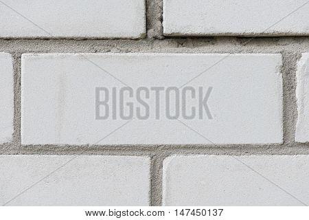 sloppy masonry of white sand-lime silicate brick