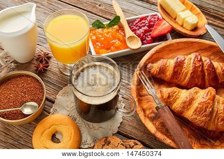 Breakfast continental with croissant coffee and orange juice