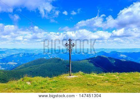 Cross on the top of Pip Ivan mountain nature landscape in Carpathians Ukraine
