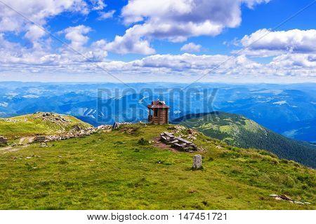 Chapel on the top of Pip Ivan mountain nature landscape in Carpathians Ukraine