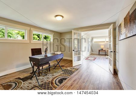 Spacious old furnished home office with hardwood floor and rug. Northwest USA