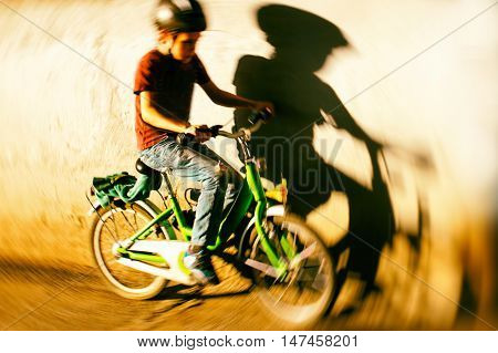 velocity. young cyclist fast racing along the wall. the concept of speed. motion blurred for concept
