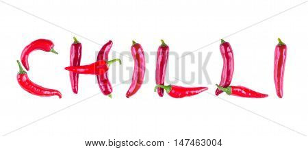 The Word Written In Red Chilli Peppers. Letters Of Red Chili Peppers. Buky Of Peppers Isolated.