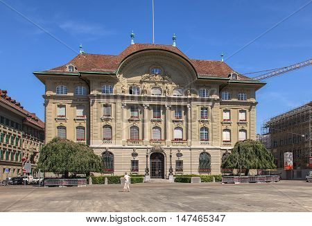 Bern, Switzerland - 11 June, 2014: facade of the Swiss National Bank building, view from Bundesplatz square. The Swiss National Bank (SNB) is the central bank of Switzerland, it is responsible for the monetary policy of the country.