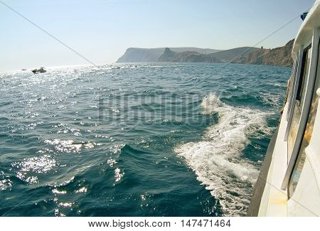 Waves on seascape in sun light at Black sea. Fish-eye lens.