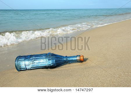 Bottle with message on a deserted shore