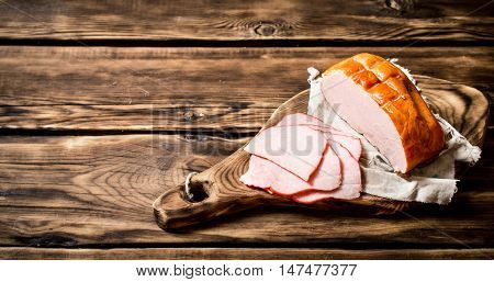 Sliced ham on the Board. On wooden background.