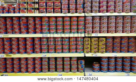 Luncheon Meat Stacked Vertically In Store