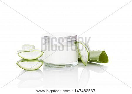 Aloe vera cosmetics. Aloe vera sliced leaf and aloe vera cosmetics isolated on white background.