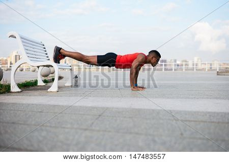 Young Black Athlete On Urban Strength Working Out