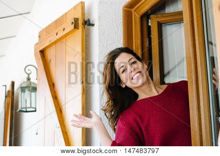 Woman Waving From Home Window