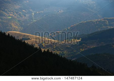 Sunrays over meadows and colorful forests at autumn, mountain Goc, Serbia