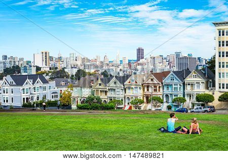 San Francisco USA - September 24 2015: The colored traditional houses of Alamo square with the cityscape on background
