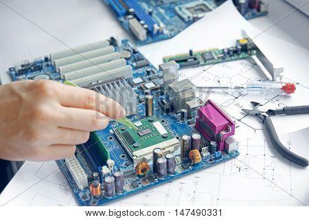 Man repairing motherboard, closeup