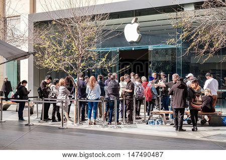 Adelaide Australia - September 16 2016: Customers lined up in the queue during the sales launch of IPhone 7 in front of Apple Store Rundle Mall