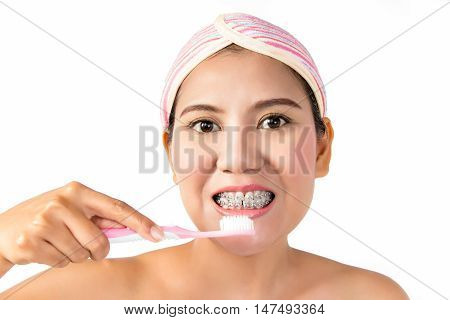 Asian woman with dental braces holding toothbrush