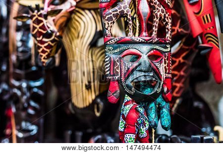 colorful traditional woodcarved tribal mask on african market