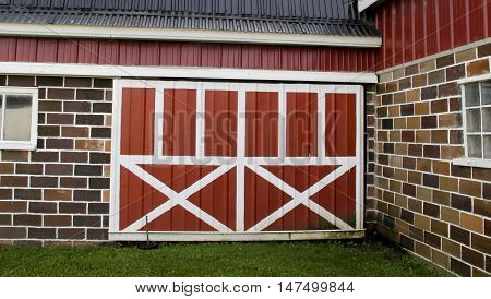 Vintage red and white barn doors on an old barn