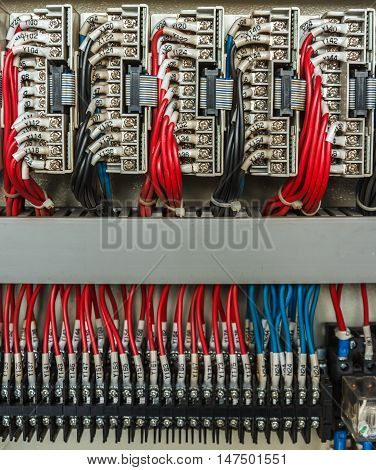 Wiring PLC,Control panel with wires in industrial factory