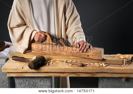 Jesus working with wood plane in carpenter's workshop