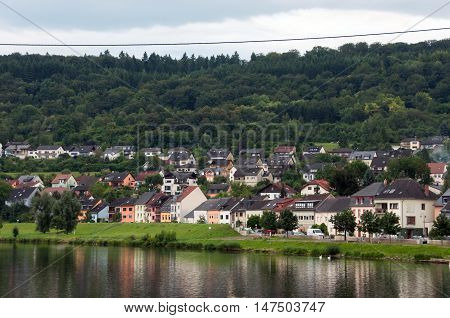 River, houses, forest and sky. On the one side of the Moselle river is Germany (in the picture), on the other is Luxembourg.