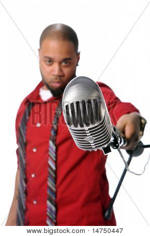 African American man with vintage microphone - Depth of Field limited to microphone