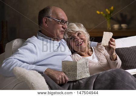 Elderly People Reading Old Letters