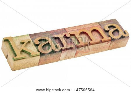 karma word - isolated text in letterpress wood type printing blocks stained by color inks
