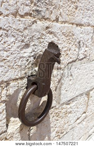 Iron ring wall close up in Gubbio Italy