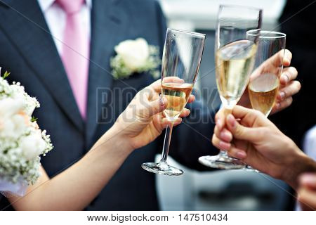 A toast of champagne to newlyweds at the wedding
