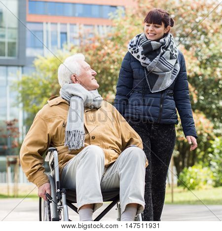 Young Woman Helping Disabled Relative